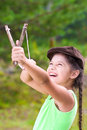 Girl with slingshot in summer Stock Photo