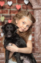 Girl with a small black dog Stock Images