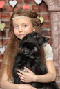 Girl with a small black dog Stock Photos