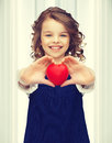 Girl with small heart picture of beautiful Royalty Free Stock Photography