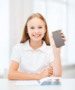 Girl with smartphone at school education technology and internet concept little student Stock Photography