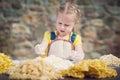 The girl smashing an egg into the flour for pasta eggs in to italian Royalty Free Stock Photos