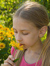 Girl smelling flower Stock Photos