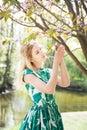 Girl smells sakura in park. Springtime, spring Royalty Free Stock Photo