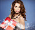 Girl smiles and holding a gift Stock Photo
