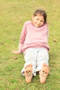 Girl with smileys on toes and soles barefoot kid funny ten two of her bare feet Stock Images