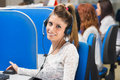 Girl smiling in call center happy cheerful support phone operator Stock Photos