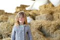 Girl smiling on a farm with hay in hair close up portrait of young Stock Images