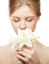 Girl smiling and with flower narcissus beautiful Royalty Free Stock Photos