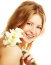 Girl smiling and with flower narcissus beautiful Stock Photos