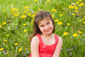 Girl Smiling in Front of Flowers Royalty Free Stock Images