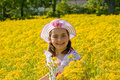 Girl Smiling in Front of Flowers Stock Photo