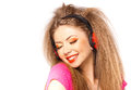 Girl smiling while listening music on headphones Royalty Free Stock Photography