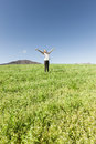 Girl smiling into the sky young enjoying life on a summer day in a beautiful grassy meadow Stock Images