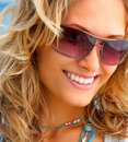 A girl smiling wearing sunglasses Stock Photo
