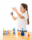 Girl sniffs a chemical reagent cautiously isolated on white Royalty Free Stock Image