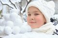 Girl with snowballs in winter Stock Photography