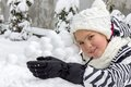 Girl with snowballs in winter Royalty Free Stock Photo
