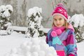 Girl with snowballs in winter Stock Images