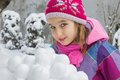 Girl with snowballs in winter Royalty Free Stock Photography
