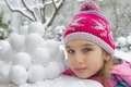 Girl with snowballs in winter Royalty Free Stock Image