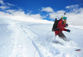 Girl snowboarder rides a snowboard towed holding rope the Stock Image