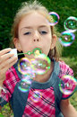 Girl with soap-bubbles Royalty Free Stock Photo