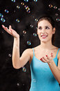 Girl and soap bubbles pretty on the black background Royalty Free Stock Photo