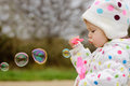 Girl with soap bubbles in spring time Stock Images