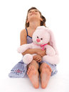 Girl with a soft toy Royalty Free Stock Photo