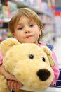 Girl with soft toy in shop Stock Image