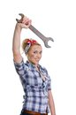 Girl with spanner Stock Images