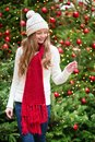 Girl with a sparkler near christmas tree Royalty Free Stock Photos