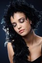 Girl with sparkly makeup and black boa elegant beautiful posing eyes closed Stock Photo