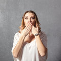 Girl in speak no evil pose Royalty Free Stock Photo