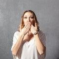 Girl in speak no evil pose Royalty Free Stock Photo