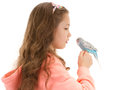 Girl speaking to tame pet bird budgerigar sitting on finger isolated on white Royalty Free Stock Image