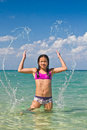 Girl splashing in the water at the beach of koh ngai island thailand Royalty Free Stock Photo