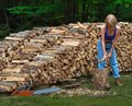 Girl splitting firewood Stock Image