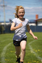 Girl in sports race Royalty Free Stock Photo