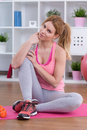 Girl in sportswear holding bottle of water Stock Images