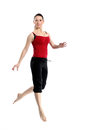 Girl in sportswear jumping over white Royalty Free Stock Photography