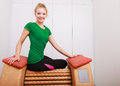 Girl in sportwear on relax massage equipment healthy spa salon Stock Photos