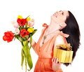 Girl with spring flower and gift box. Stock Photo