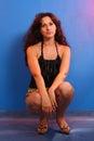 Girl squatting in studio Royalty Free Stock Photo