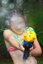 Girl with squirt gun Royalty Free Stock Photo