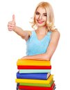 Girl with stack book showing thumb up. Stock Image
