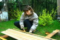 Girl is staining boards Royalty Free Stock Photography