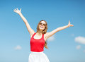Girl standing on the beach summer holidays and vacation concept holding hands up Stock Photography