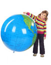 Girl standing and holding big inflatable globe